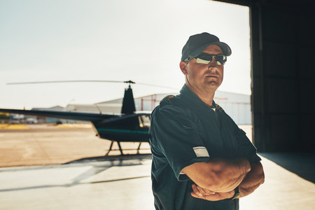 Confident helicopter pilot in uniform