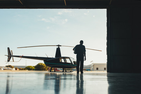 Pilot walking towards helicopter
