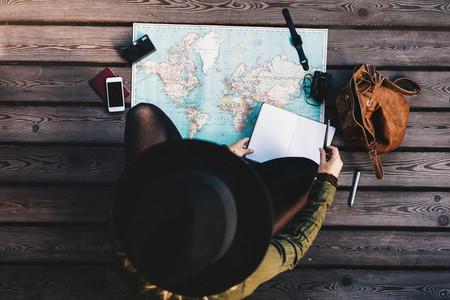 Tourist exploring the world map