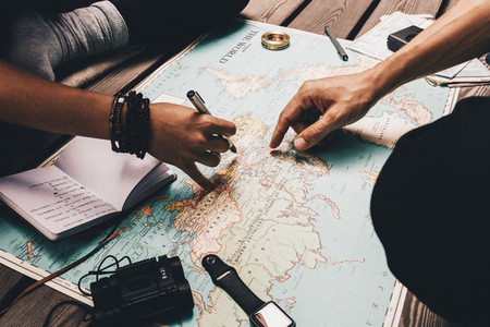 Couple planning vacation using the world map