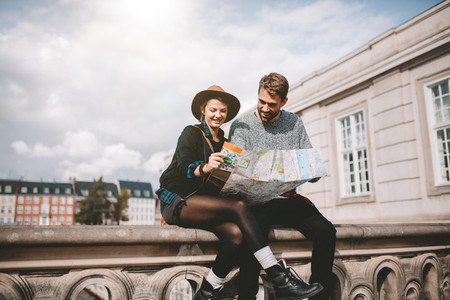 Young couple looking at a city map