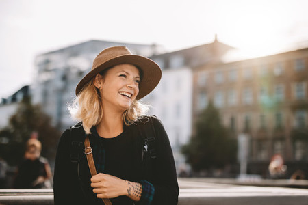 Smiling tourist woman wearing hat