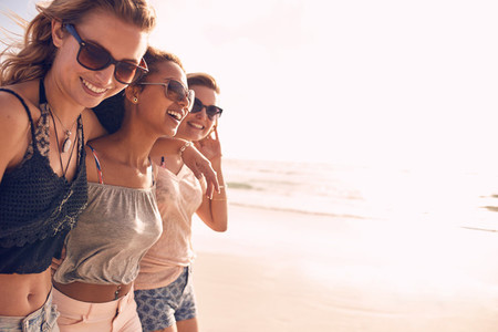Group of young women enjoying vacation on beach