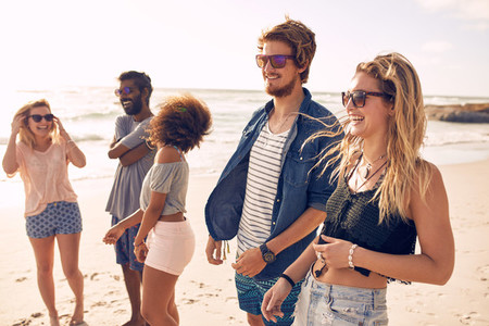 Group of friends having fun on the beach