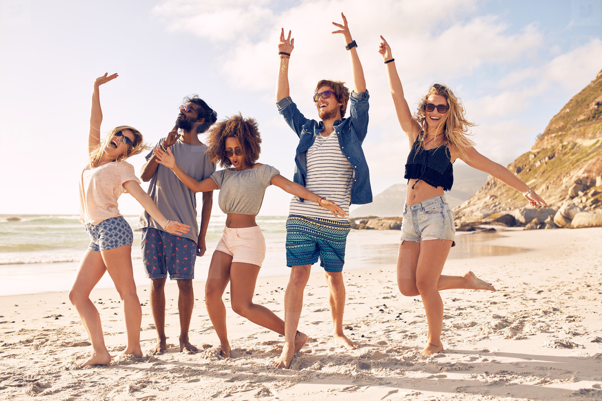 Group of friends having fun at beach