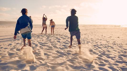 Friends running a race on the beach