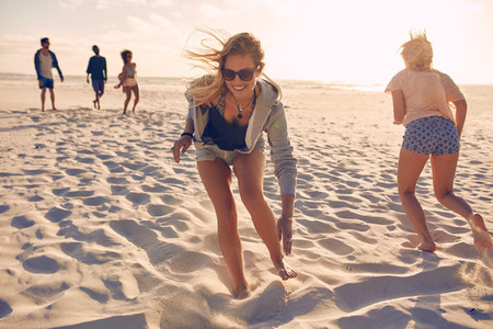 Friends playing games on the beach