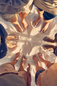 Feet of young people standing in a circle