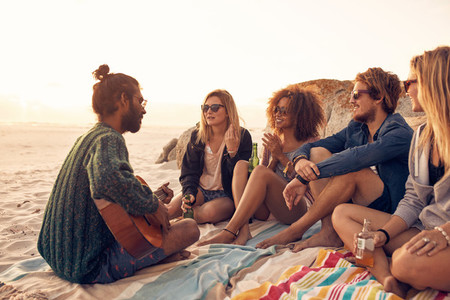 Young people having a party on the beach