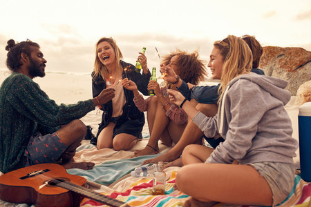 Happy friends partying on the beach