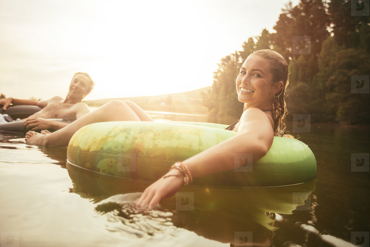 Young couple relaxing in water on a summer day