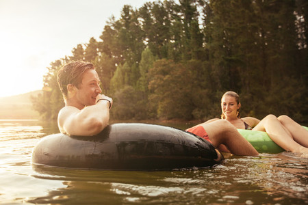 Couple relaxing in water on a summer day
