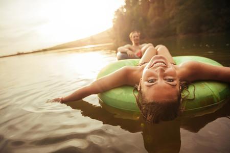 Young girl in lake on innertube