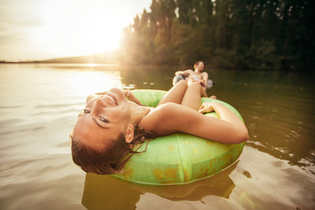 Young woman relaxing on inner tube in water