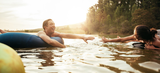 Loving young couple having fun in the lake