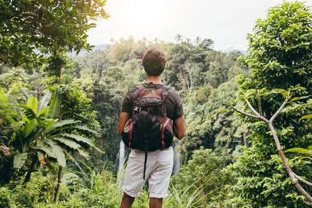 Male hiker admiring the waterfall