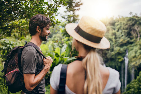 Young man standing with his girlfriend in forest