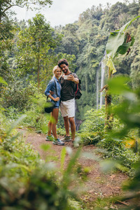 Loving young couple in forest taking self portrait