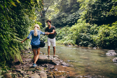 Couple in forest by the stream