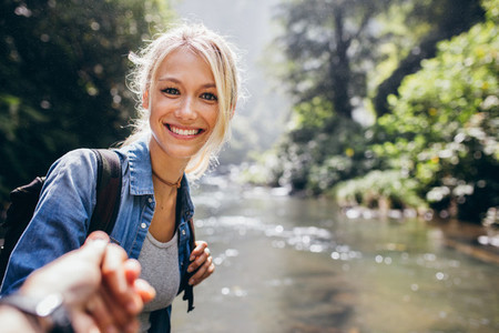 Woman enjoying a hike in nature with her boyfriend