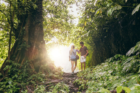 Couple hiking in tropical jungle