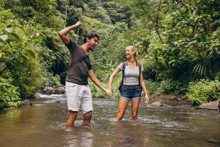 Couple having fun together outdoors on a hike