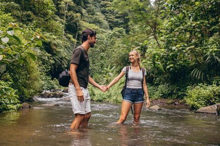 Loving young couple in forest stream