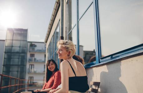 Three young women sitting in balcony