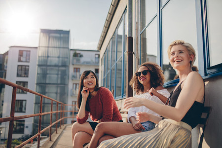 Smiling women relaxing outdoors in terrace