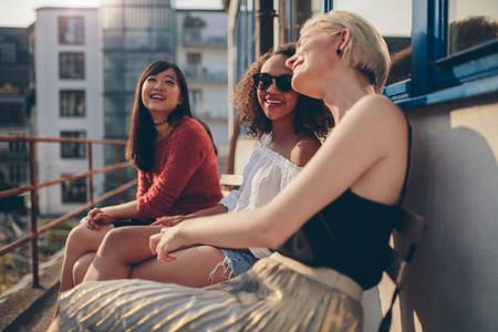 Female friends having fun in balcony
