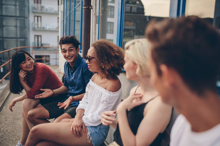 Group of young people relaxing in terrace