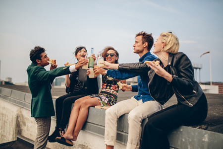 Group of friends celebrating on rooftop