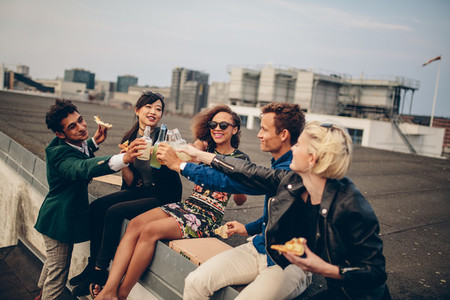 Diverse group of young friends on terrace party