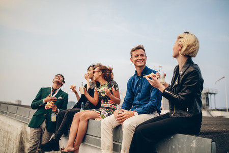 Group of young friends partying on terrace