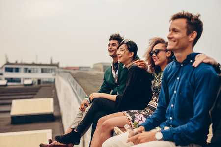 Friends sitting together on rooftop