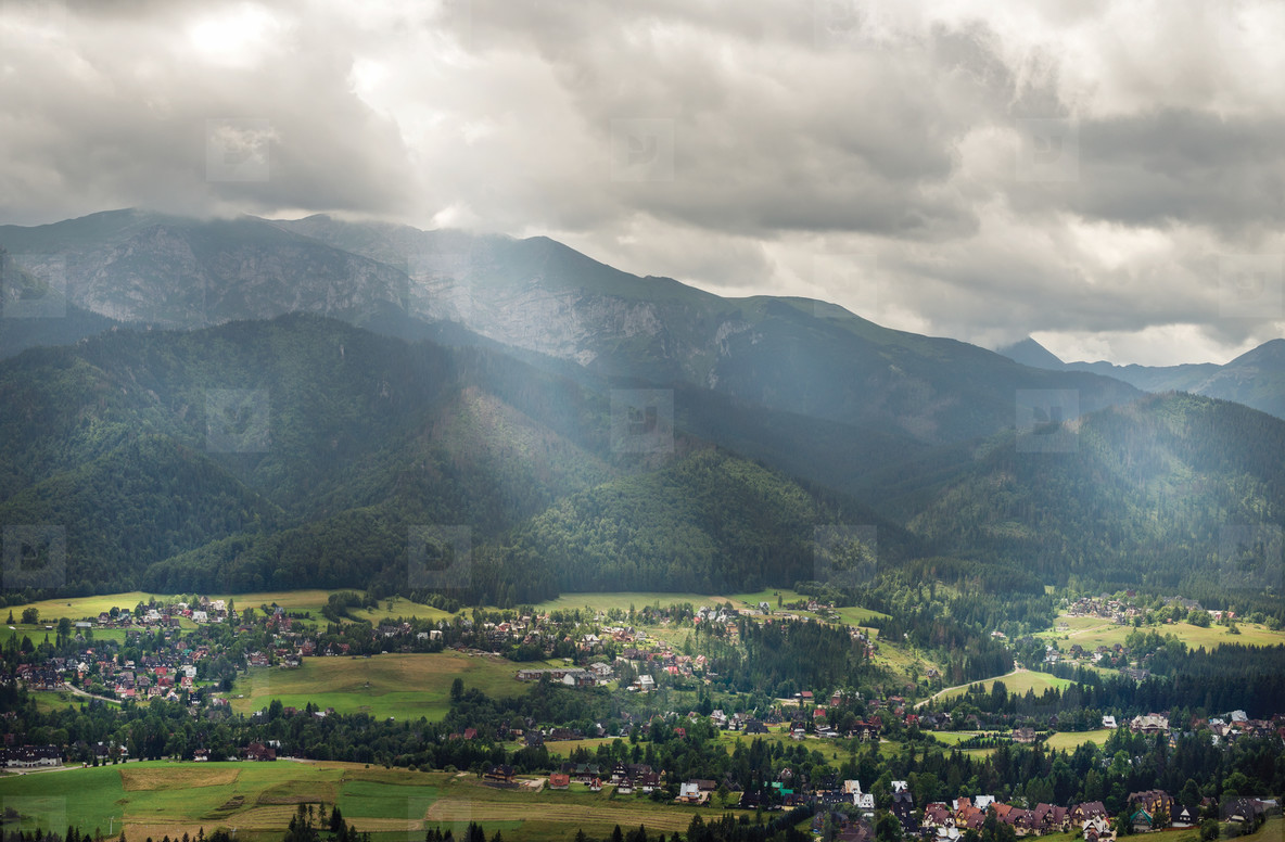 View over green valley  village and mountains in Zakopane  Poland