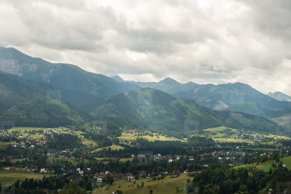View over green valley  village and mountains  Poland
