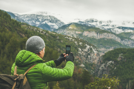 Young man traveller making photo of mountains  Alanya  Turkey
