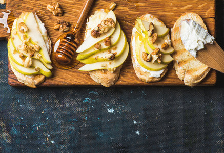 Crostini with pear  ricotta cheese  honey and walnuts