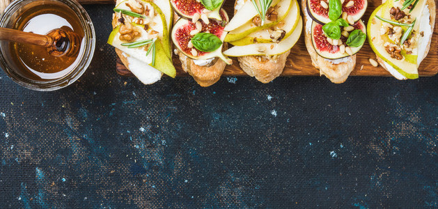 Crostini with pear ricotta cheese honey figs nuts and herbs