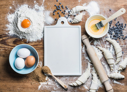 Baking ingredients for cooking croissants with white board in center