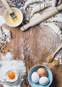 Baking ingredients for cooking croissants over wooden background  copy space