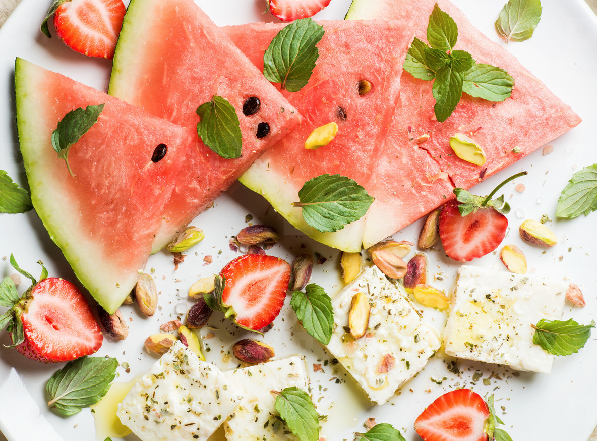 Summer watermelon  strawberry and feta cheese salad with pistachios