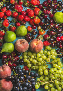 Healthy summer fruit variety Black and green grapes strawberries figs sweet cherries peaches