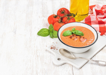 Cold gazpacho soup with ice  basil and tomatoes  copy space