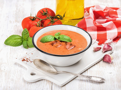 Cold gazpacho soup with ice  basil and fresh tomatoes