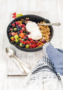 Oat granola crumble with berries seeds and ice cream