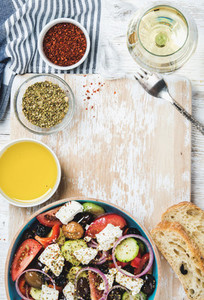 Greek salad with olive oil bread herbs and white wine