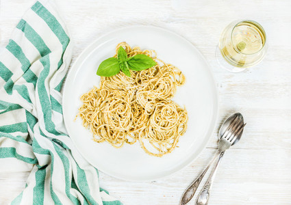 Pasta spaghetti with pesto sauce  fresh basil and white wine