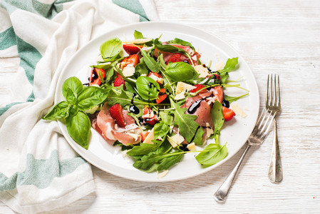 Summer arugula prosciutto and strawberry salad